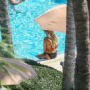 Sylvie Meis in Black Bikini on the pool in Miami - 454 x 303