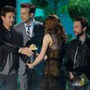 Actres Emma Stone accepts the Best Comedic Performance award onstage during the 2011 MTV Movie Awards at Universal Studios' Gibson Amphitheatre on June 5, 2011 in Universal City, California