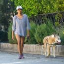 Regina King – Takes her dog out for a walk in Los Angeles