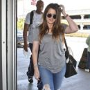 Khloe Kardashian and Lamar Odom catching a flight at LAX airport in Los Angeles, CA (July 17)