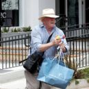 Nick Nolte sprays the paparazzi with a toy water gun while shopping with his daughter Sophie in Malibu