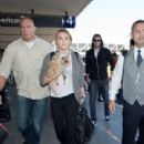 Miley Cyrus was spotted catching a departing flight out of the Los Angeles International Airport today, September 27 - 300 x 359