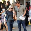 A smitten looking Dakota Fanning and her boyfriend Jamie Strachan go hand in hand for a stroll around New York City