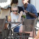 A barefaced Amanda Seyfried drinks a green smoothie while eating sushi with friends at Urth Cafe in West Hollywood