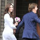 Blushing bride Nancy Shevell can't stop beaming as she and Sir Paul McCartney set off for their wedding