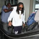 Snoop Dogg is seen at LAX on March 31, 2016
