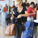 Malin Akerman departing on a flight at LAX airport in Los Angeles, California on January 26, 2015 - 376 x 600