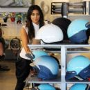 Kim Kardashian: visiting a Vespa scooter store in Miami