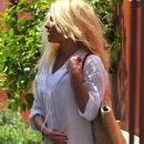 Pamela Anderson spotted out at the Brentwood Country Mart in Brentwood, California on March 28, 2012