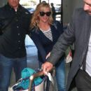 Reese Witherspoon is seen boarding a departing flight at LAX in Los Angeles, California on March 26, 2017 - 420 x 600