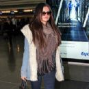 Selena Gomez makes her way through the airport at JFK in New York City. January 18, 2012 - 349 x 594
