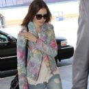 Lily Collins arriving at LAX airport in Los Angeles, CA (July 27)