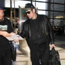 Benicio Del Toro is seen at LAX on April 12, 2016 - 400 x 600
