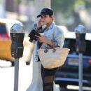 Vanessa Hudgens – Pays the meter in Los Angeles