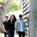 Joe Jonas and his girl toy head to a pet adoption center together on Monday August 10,2015 in Los Angeles