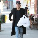 Evan Ross stops to pick up some lunch to go in Sherman Oaks, California on December 19, 2014 - 429 x 594