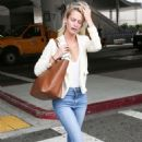 Poppy Delevingne – Arriving at LAX Airport in Los Angeles - 454 x 681