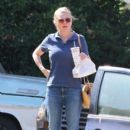 Kirsten Dunst grabs some lunch while she was out and about in Los Angeles, California on October 14, 2016. She looked very eager to eat her In and Out