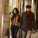 Mila Kunis with Ashton Kutcher: bundled up on the streets of Rome