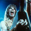 Christopher Guest rocks out as co-lead guitarist Nigel Tufnel in This Is Spinal Tap - 1984, re-released by MGM in 2000