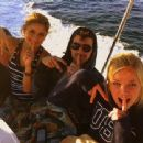 Joe Jonas hangs out with his friends on a boat
