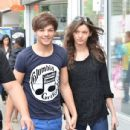 LE1 Louis Tomlinson held tight to his girlfriend, Eleanor, as they strolled through the streets on Toronto yesterday, May 31
