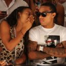 Angela Simmons and Bow Wow attend the Trina Turk 2011 fashion show during Mercedes-Benz Fashion Week Swim at the Raleigh on July 15, 2010 in Miami Beach, Florida.
