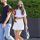 Olivia Culpo – In mini skirt shopping in Beverly Hills