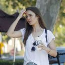 Lily Collins in Jeans Shorts and Charlie Mcdowell – Out in Los Feliz - 454 x 671