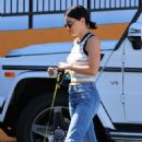 Lucy Hale – Arrives at Sam's Green Paw with Elvis in LA