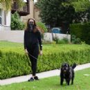 Troian Bellisario – Out for a walk with her dog in Los Angeles - 454 x 474