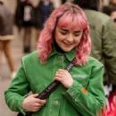 Maisie Williams in Green Jacket at Heron Preston Show in Paris - 454 x 681