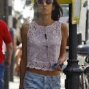 George Clooney's fiancée Amal Alamuddin reveals her toned tum in lacy light pink crop top and patterned pastel jeans as she runs errands