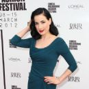 Dita Von Teese arrives at the David Jones Show and launch of L'Oreal Melbourne Fashion Festival on March 8, 2012 in Melbourne, Australia