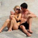 Paris Hilton cuddling up to her new boyfriend in Corsica, France (August 6)