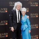 Brian May and Anita Dobson attend The Olivier Awards with Mastercard at Royal Albert Hall on April 8, 2018 in London, England - 409 x 600