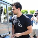 Taylor Lautner and his girlfriend  were seen leaving Fred Segal in West Hollywood, California on March 23, 2017 - 454 x 600