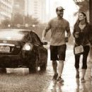 CM Punk and Lita walking in the rain - 400 x 224