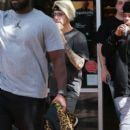 Justin Bieber and his crew stop by a Starbucks for an iced coffee in Los Angeles, California on March 22, 2016