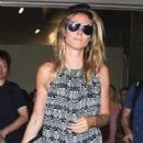 Heidi Klum and her boyfriend touch down at LAX airport in Los Angeles, Califronia on July 31, 2016 - 418 x 600