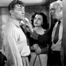 Robert Mitchum and Faith Domergue