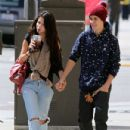 Justin Bieber and his girlfriend Selena Gomez hold hands as they head to Panera Bread for lunch on April 5, 2012 in Glendale