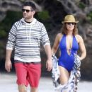 Alyssa Milano proves she's fabulous at 40 in plunging swimsuit on romantic Hawaii break