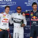 Pole sitter Lewis Hamilton (C) of Great Britain and Mercedes GP celebrates in parc ferme with second placed Sebastian Vettel (L) of Germany and Infiniti Red Bull Racing and third placed Mark Webber (R) of Australia and Infiniti Red Bull Racing following q