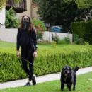 Troian Bellisario – Out for a walk with her dog in Los Angeles - 454 x 489