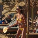 Izabel Goulart in Yellow Bikini at the beach in Mykonos