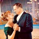 Rita Hayworth and John Wayne