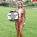 Joanna Krupa – Bodypaint while protesting outside Westminster in London - 454 x 574
