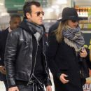 Lovebirds Jennifer Aniston and Justin Theroux wear matching black as they dash out of New York City hotel