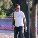David Beckham is spotted in a white t-shirt and denim jeans as he takes his children to soccer practice in Los Angeles